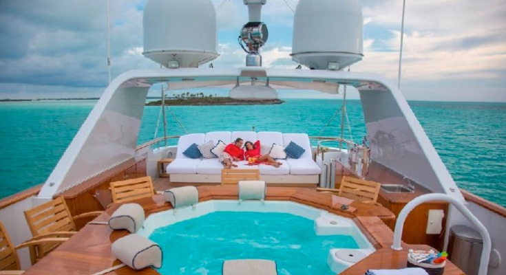 relaxing aboard the motor yacht Lady J, available via Carol Kent Yacht Charters