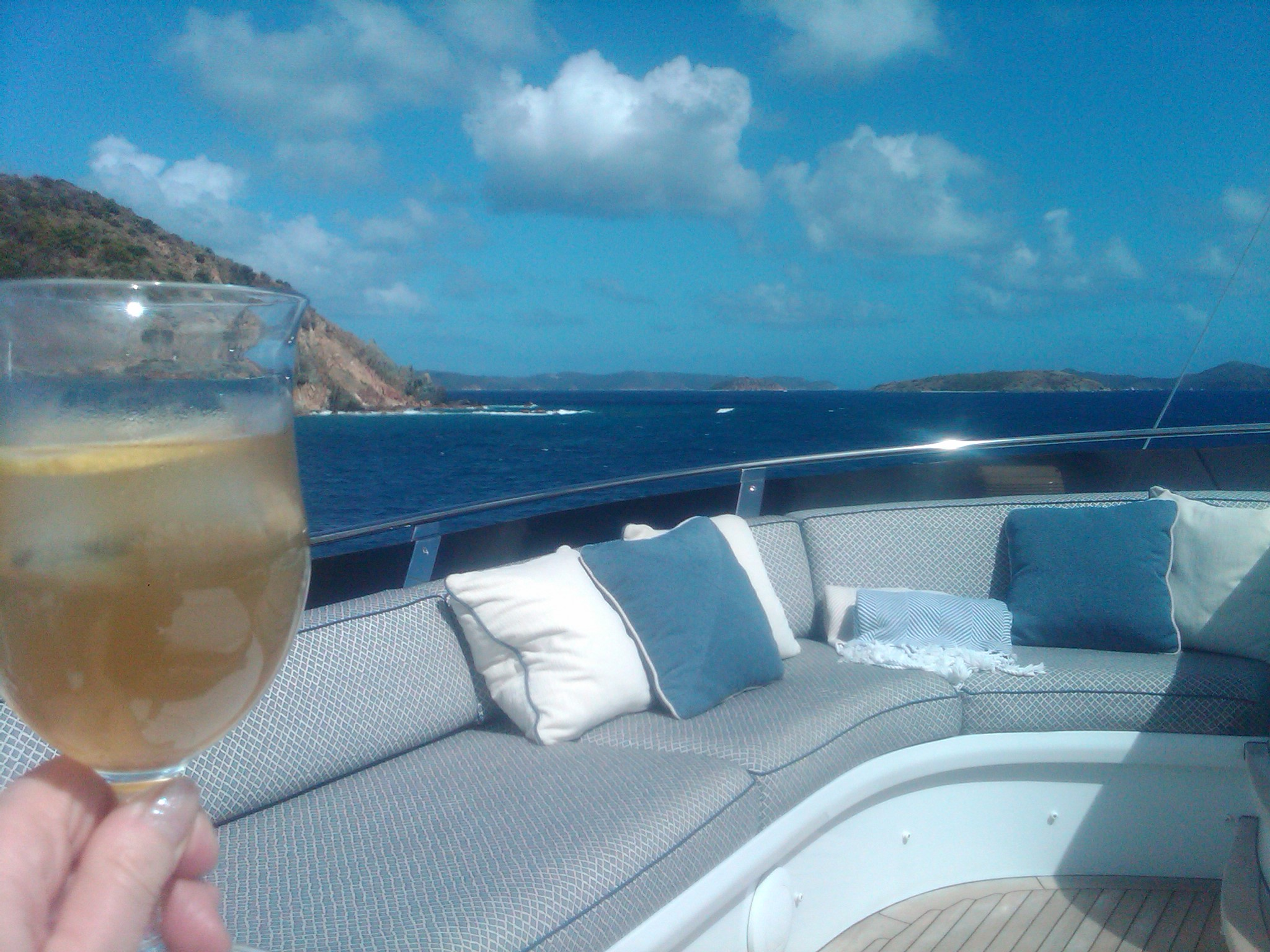 Wine glass toasting the journey on Tea Time Top Deck