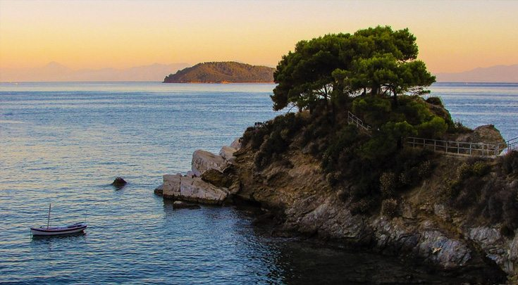 Island in the Sporades, Greece with a boat at sunset