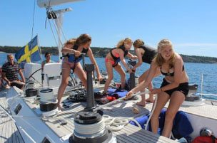 Girls working line on board the sailing yacht Ichiban Sweden
