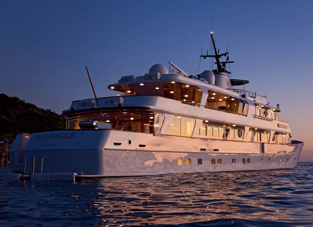 172' motor yacht BIG EAGLE's aft deck at sunset with evening lighting