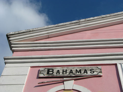 Bahamas sign on classic pink building in Bimini