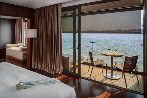 Connecting suite with floor-to-ceiling windows on the Aqua Mekong cruise on the Mekong River