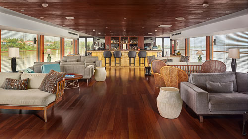 Indoor lounge and bar on the 5-star AQUA MEKONG cruise on the Mekong River