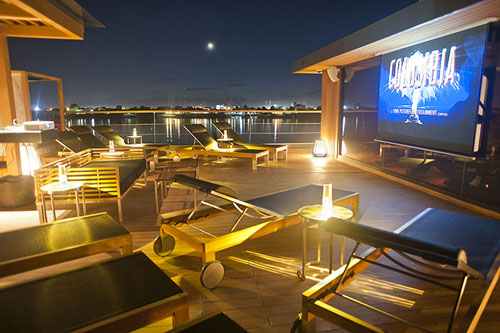 Aqua Mekong's outdoor on deck cinema at night