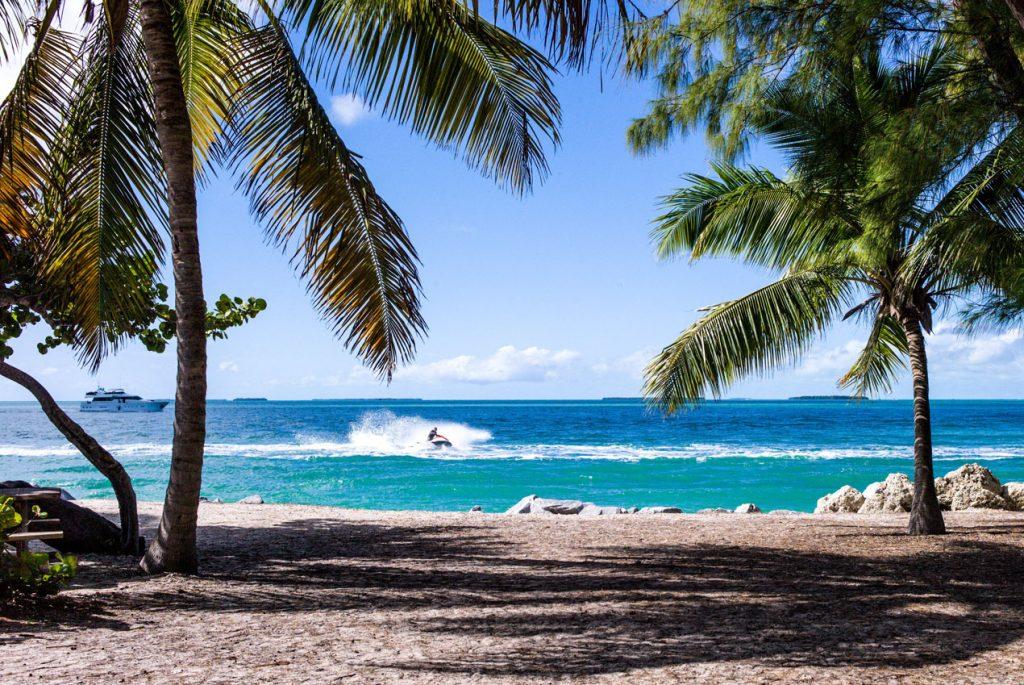 Jet ski and yacht from Caribbean beach