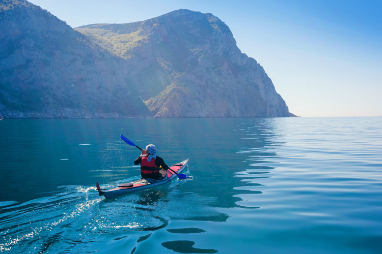 Man kayaking in the sea.