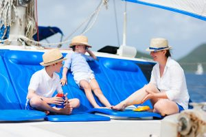 Mother and kids at luxury yachton a luxury yacht, catamaran or sail boat