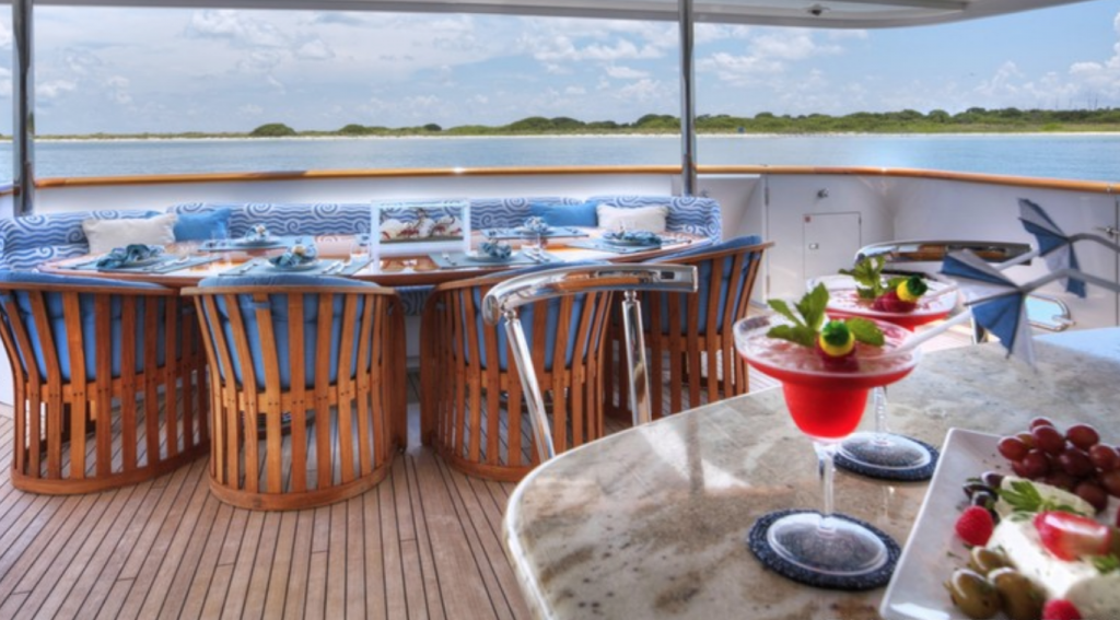 Aft deck al fresco dining on motor yacht I LOVE THIS BOAT