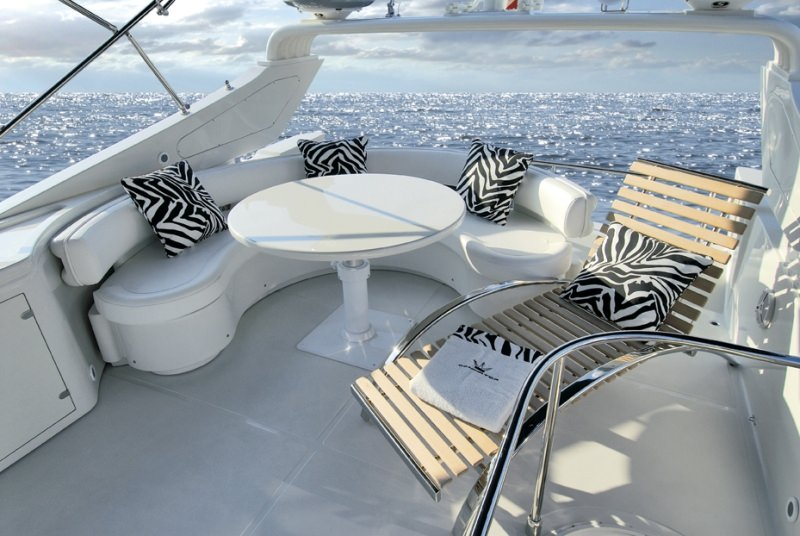 Aft deck settee and lounging area on the 62ft Dominator motor yacht JACO