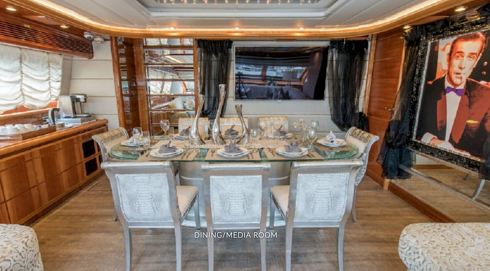 Dining/media room with James Bond photo on 94ft motor yacht OOZ