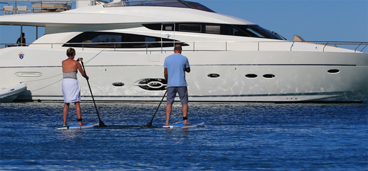 Stand up paddle board couple off the motor yacht SOPHIA