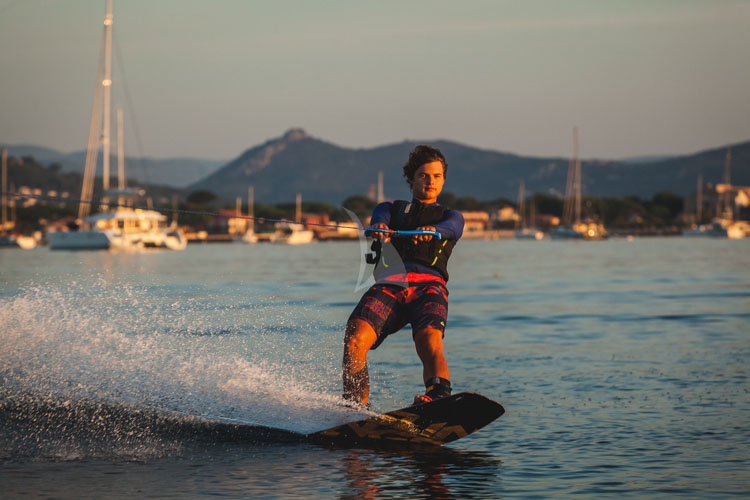 Waterskier at sunset off 62ft sailing yacht catamaran OCEAN VIEW