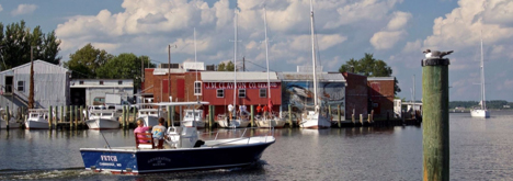 Boat cruising through harbor in Cambridge, Maryland