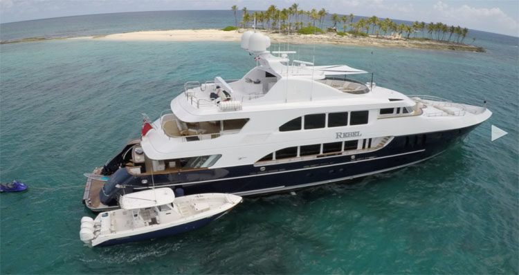 157ft Trinity motor yacht REBEL with its Everglade tender in shallow Caribbean water