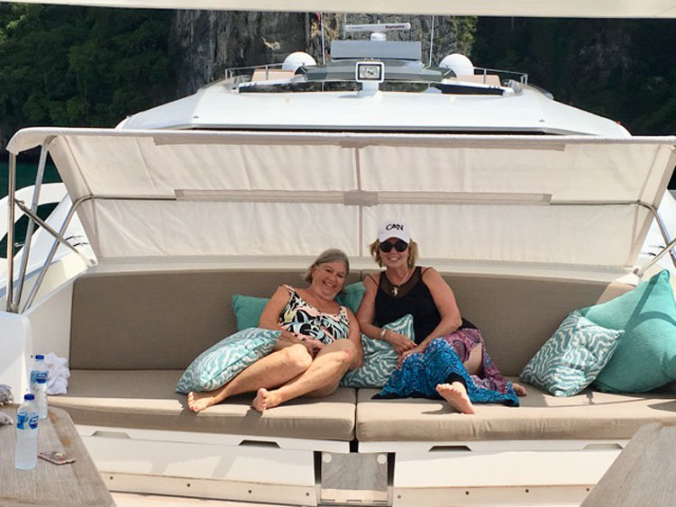 Carol and friend Louise Daley relaxing on the 108ft motor yacht DOLCE VITA in Thailand