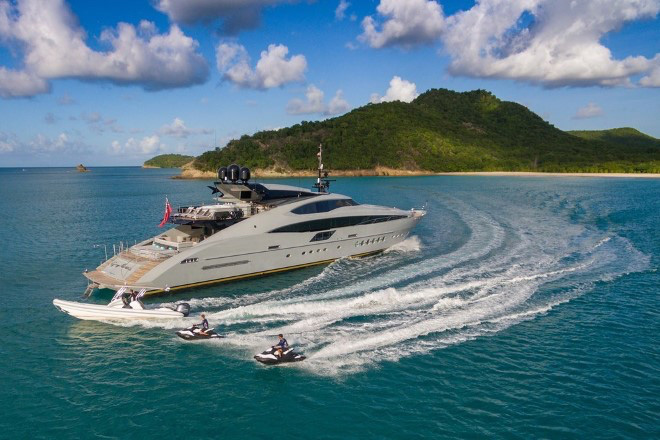 150ft Palmer Johnson motor yacht Grey Matters with jet skis. Operating in the Bahamas