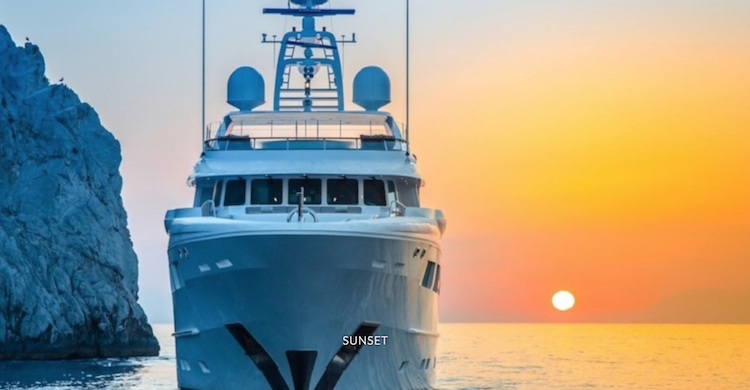 Head on shot of 128ft Hakvoort motor yacht REVELRY at sunset