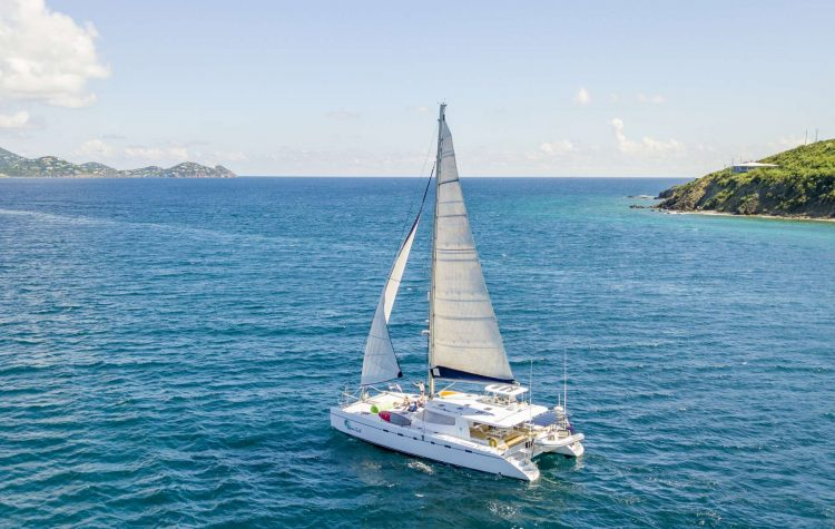 60ft Nexus sailing yacht catamaran on the ocean operating in the Caribbean