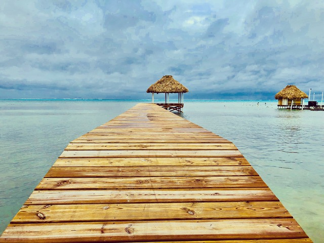 Dock leading out to pavilions in Belize's blue water