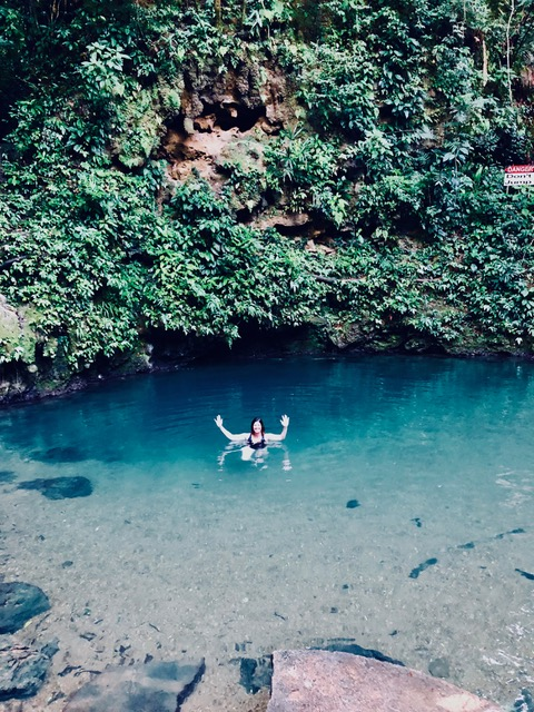 Molly luxiuriating Cayo's famous Blue Hole in Belize