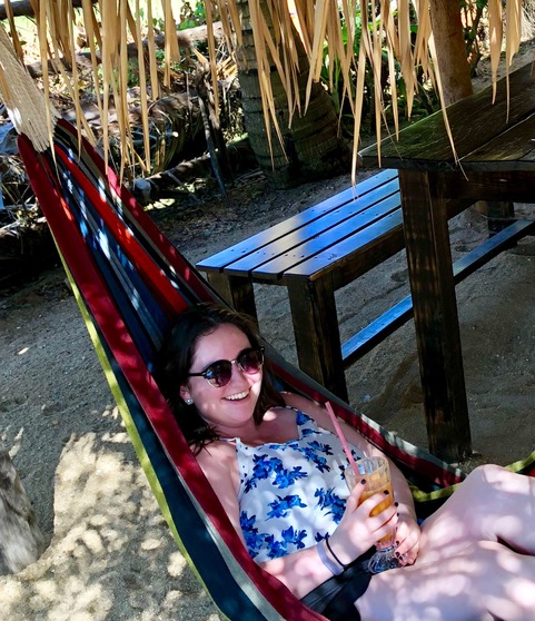 Molly Gearan swinging in a colorful hammock in Belize