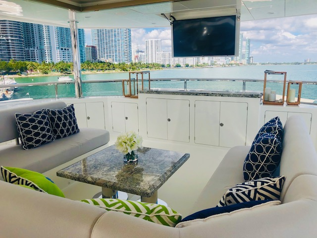 Aft deck lounge on The Rock, 120ft Ocean Alexander motor yacht at the Miami Yacht Show 2019