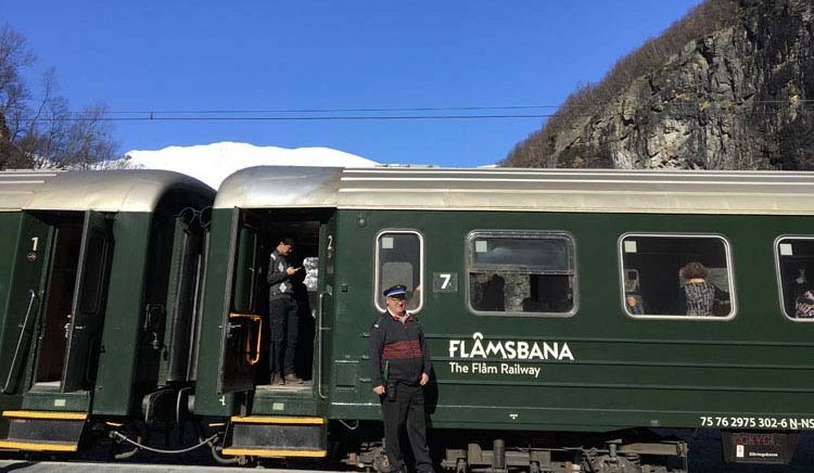 Flambana railway car with proud engineer on the Flam Railway in Norwegian fjords, Norway