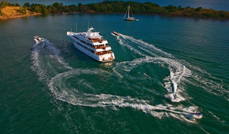 Motor yacht BLUE MOON's jet skis make a heart-shaped wake behind the 198ft Feadship yacht