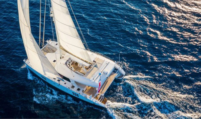 Aerial view of 70ft Sunreef catamaran OMBRE BLU³ in the Western Mediterranean