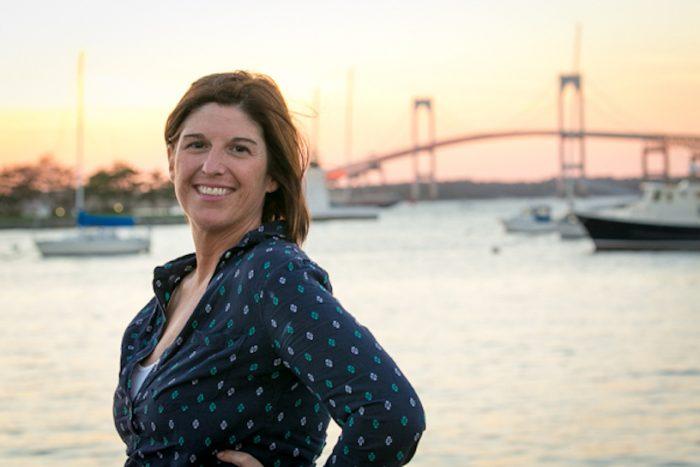 Yacht charter broker Sue Gearan at the bridge in Newport, Rhode Island