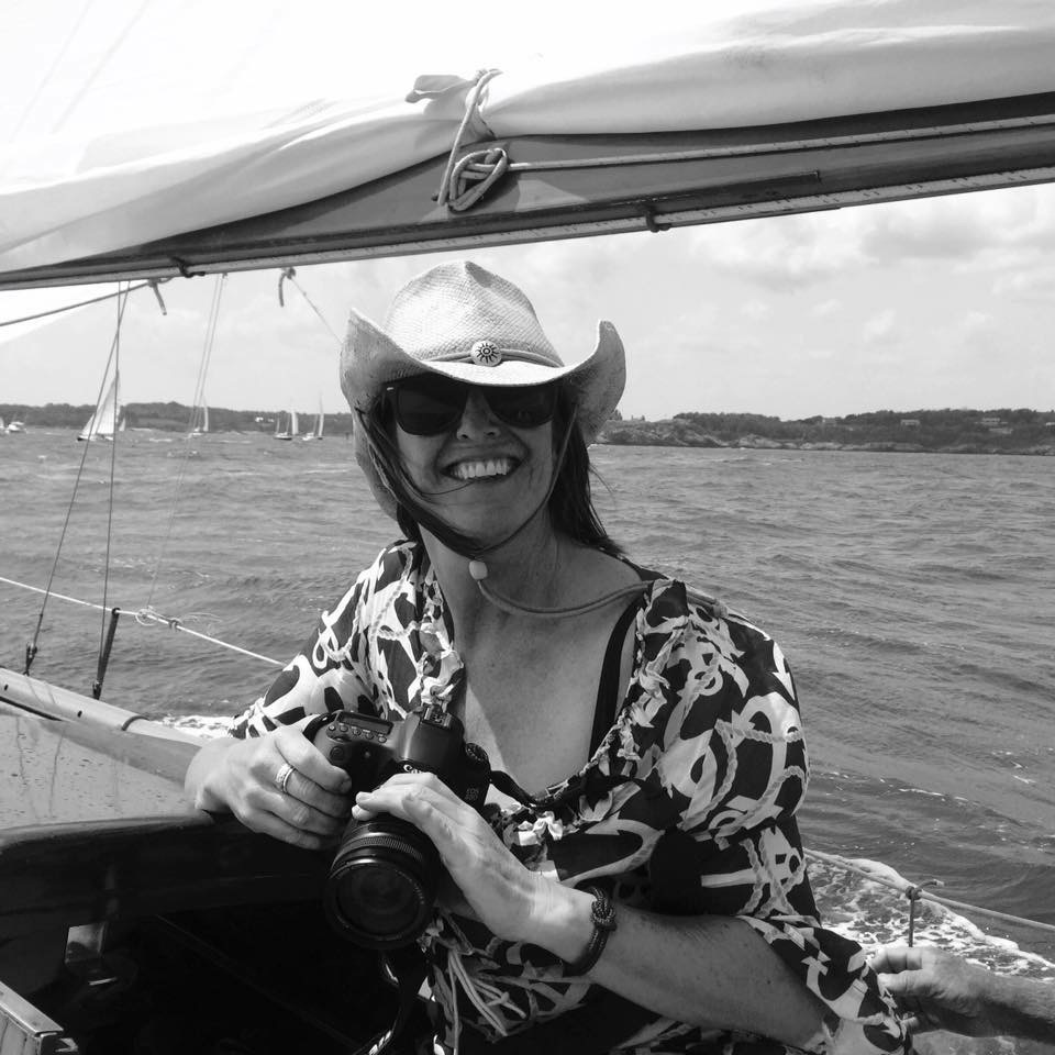 Sue Gearan with camera on board a sailboat