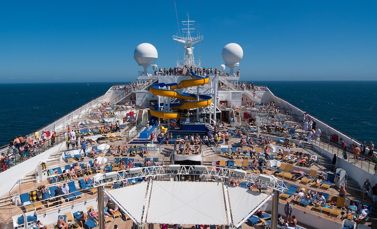 Cruise ship deck with deck chairs, water slide and trampolines. Photo by MustangJoe