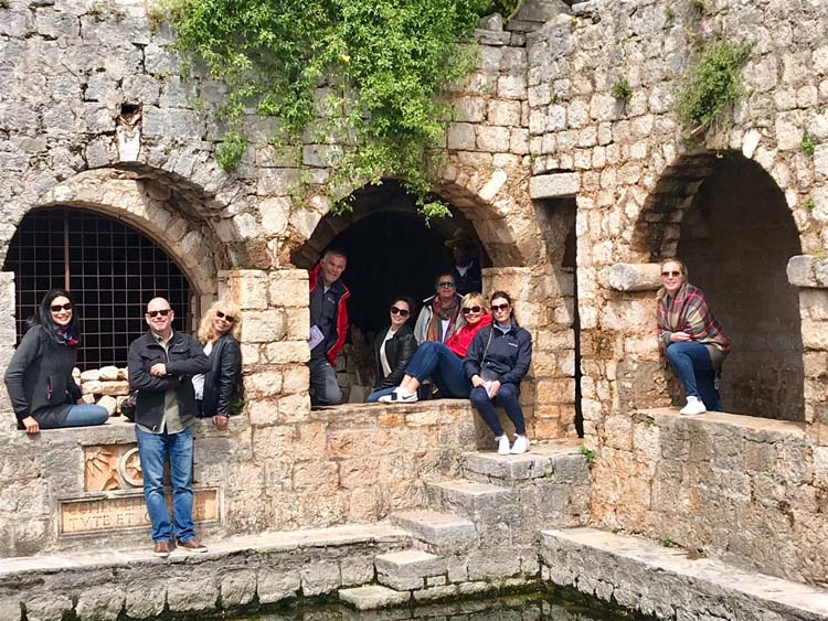 Carol with fellow yacht charter brokers at Courtyard Pond at Tvrdalj Fortress, Stari Grad, Hvar, Croatia