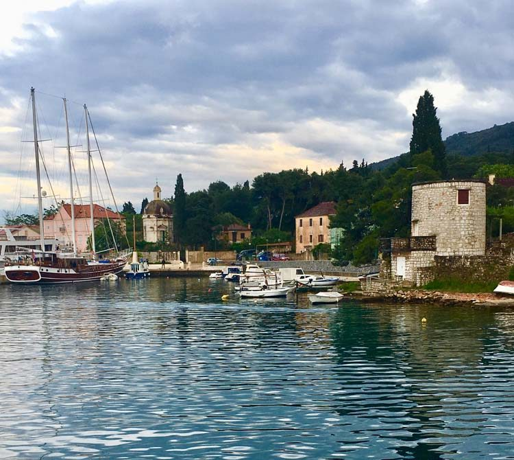 Stari Grad harbor in Croatia with lovely stone buildings and boats