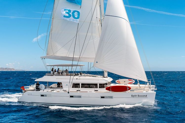 Profile of Twin Flame 62ft Lagoon sailing yacht catamaran at sea in The Bahamas