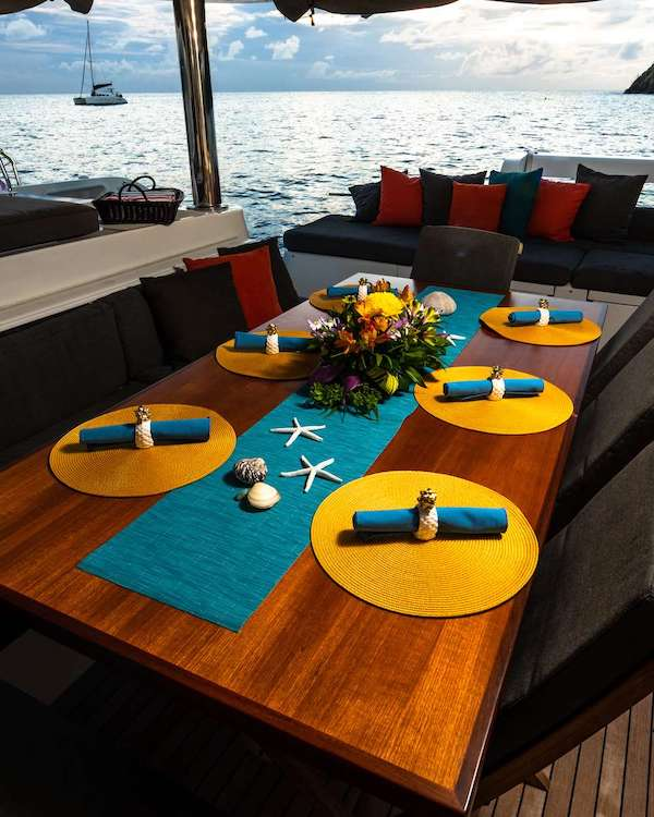 Al fresco breakfast Nook with starfish table setting on 62ft Lagoon Sailing Catamaran