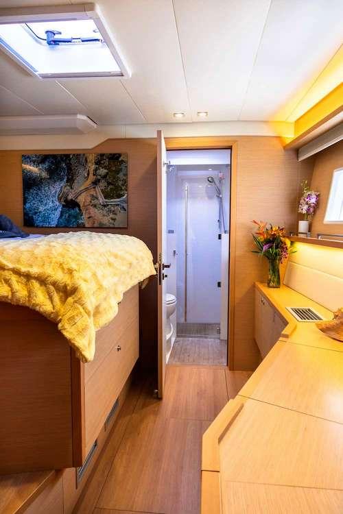 Cabin with glass shower aboard sailing catamaran TWIN FLAME