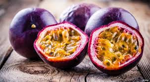 Passion fruit whole and cut in half
