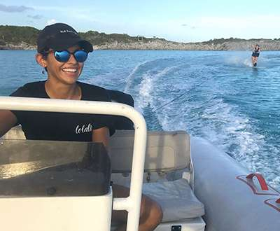 First Mate Raven of sailing catamaran LOLALITA driving the boat's tender