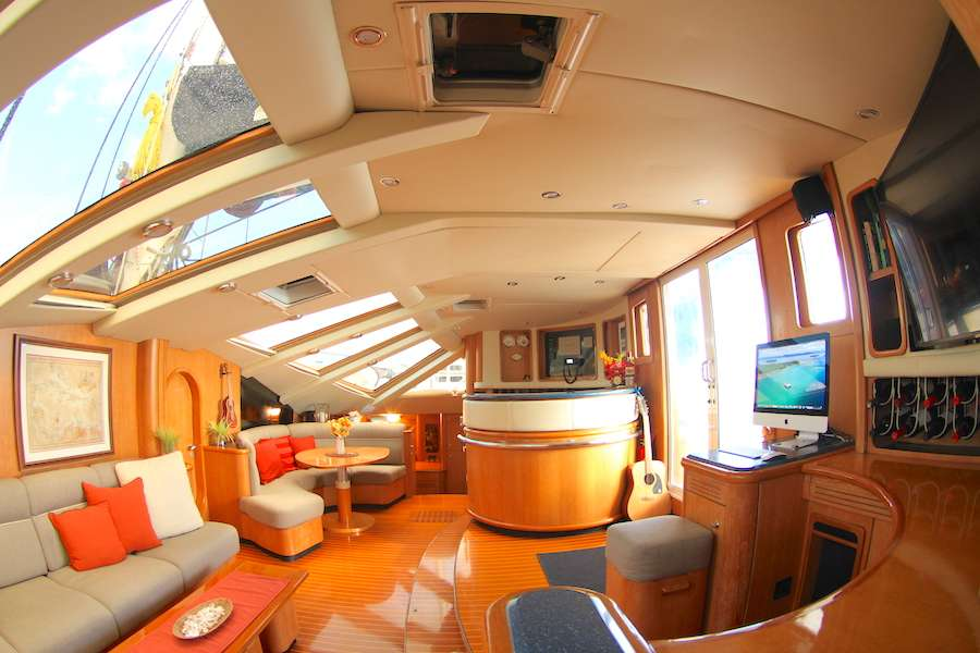 Saloon of the sailing catamaran LOLALITA with bar