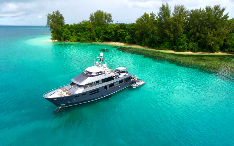 112ft motor yacht AKIKO anchored off island in Papua, New Guinea