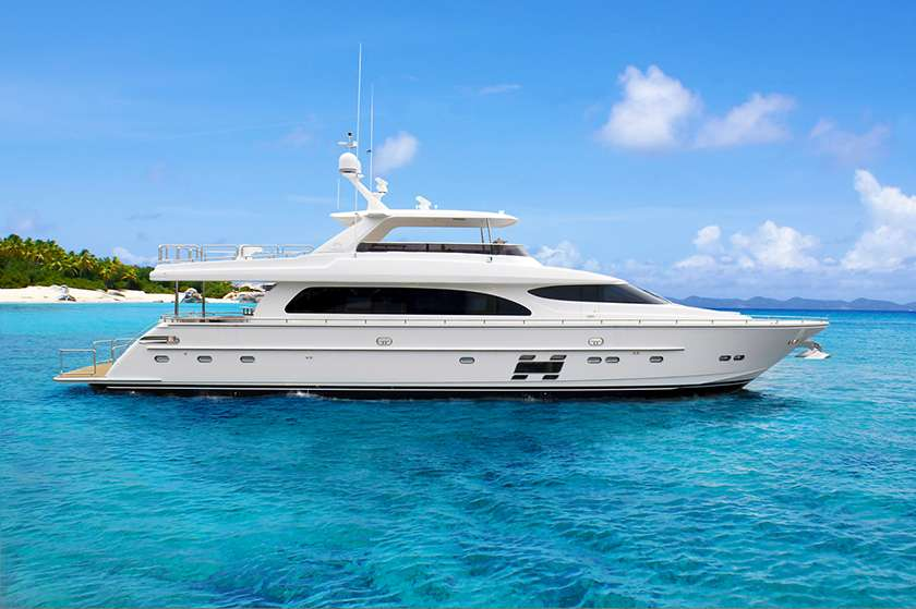 91ft Horizon motor yacht AQUA LIFE at anchor in its cruising area, The Caribbean and The Bahamas