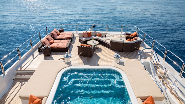 Aft deck with jacuzzi and lounge furniture aboard the 205ft Oceanco motor yacht LUCKY LADY