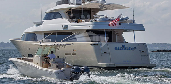 86ft custom-built SLAINTE III motor yacht seen here with its tender operates in North America and the Bahamas