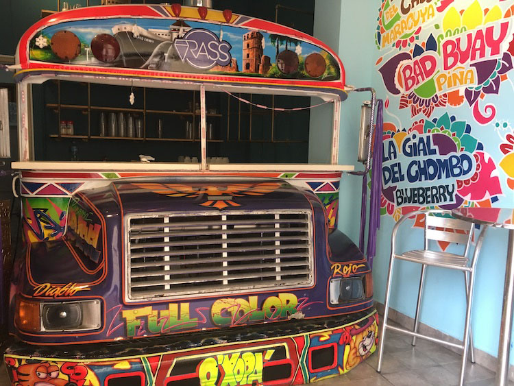Smoothie bar uses colorful revamped school bus as store front in Panama
