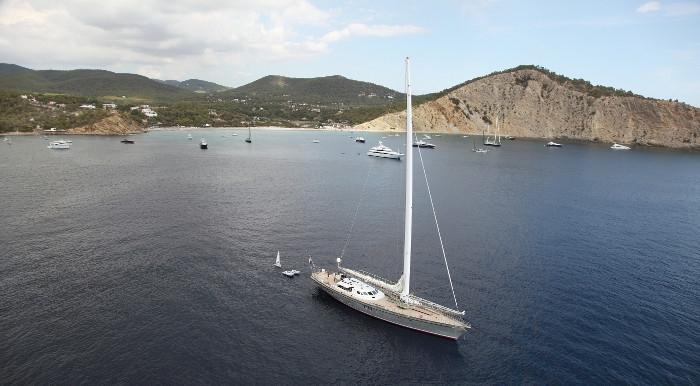 159ft custom-built mega sailing yacht DWINGER moored in harbor with tenders