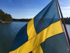 SwedishFlagWaterBehind_sail yacht ichiban menu