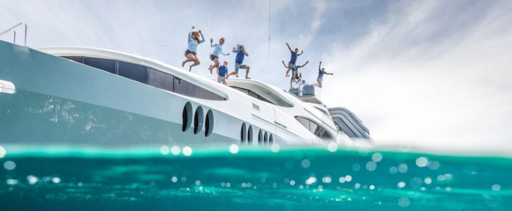 Family jumping into Caribbean from M/Y ZOOM ZOOM ZOOM